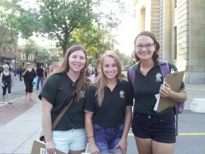 CCNB interns canvassing at Harvest Jazz and Blues Festival, featuring our bag-like 90's CCNB polos